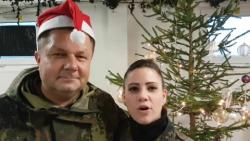 Belgian and German Air Force soldiers with the NATO Air Policing mission in the Baltics send Christmas greetings home