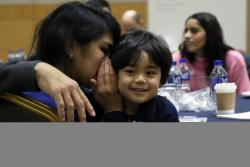 Mother, child share a moment during a relationship-enhancement training event
