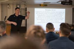 U.S. Navy Chaplain preaches aboard the aircraft carrier USS John C. Stennis (CVN 74)